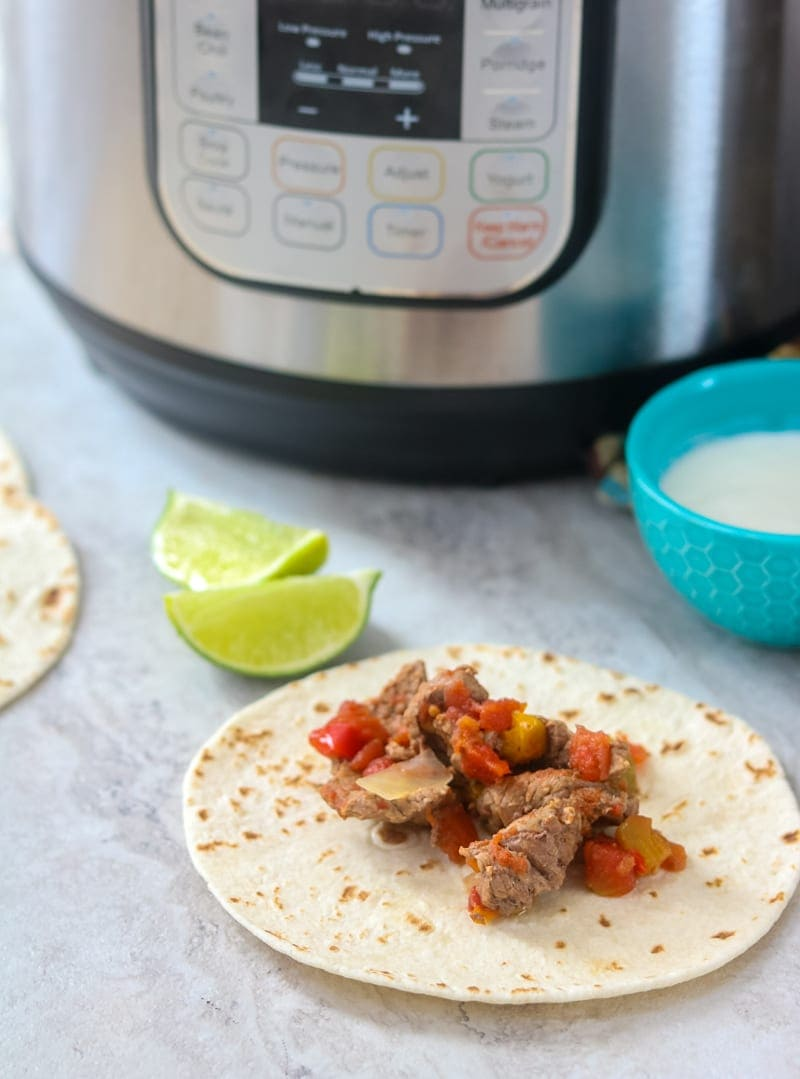 steak fajita next to instant pot and lime