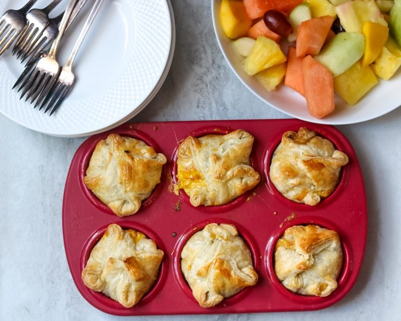 Easy Breakfast Quiche baked in red muffin tin