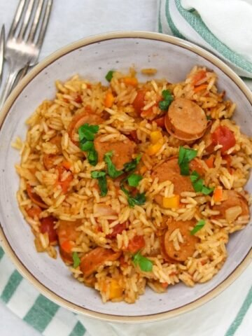 Bowl of Instant Pot Jambalaya topped with parsley