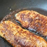 Tilapia in skillet with spice rub