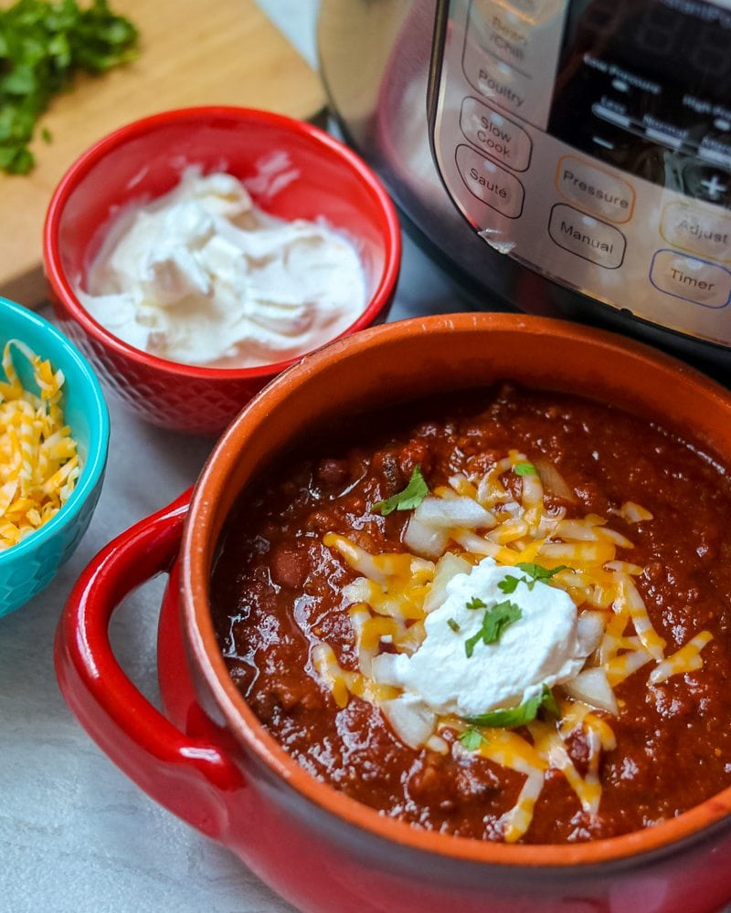 Close up of Classic Beef Chili with sour cream and cheese