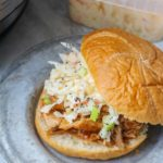Pulled pork on bun with apple coleslaw