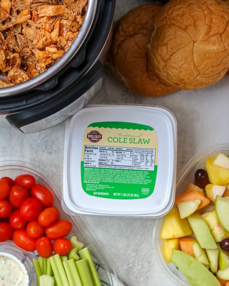 Pulled pork with fruit and veggie trays with coleslaw