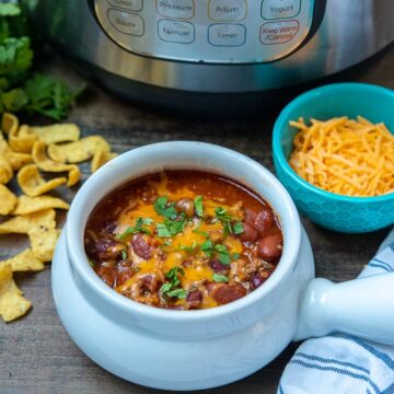 Bowl of Instant Pot Chili topped with cheese