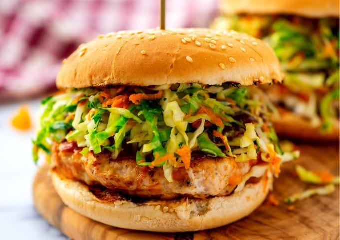 Close up of Chicken Burger topped with slaw
