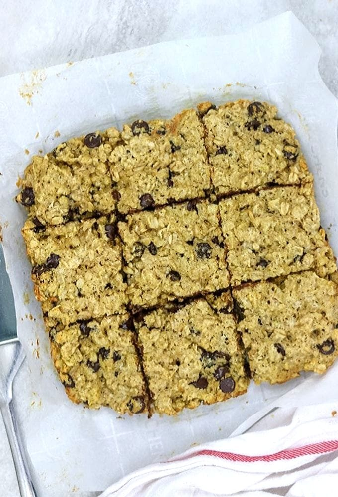 Oatmeal Bars on parchment paper cut into 9 bars
