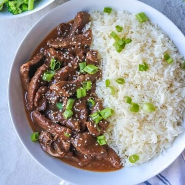 Instant Pot Mongolian Beef dished up in white serving platter with white rice