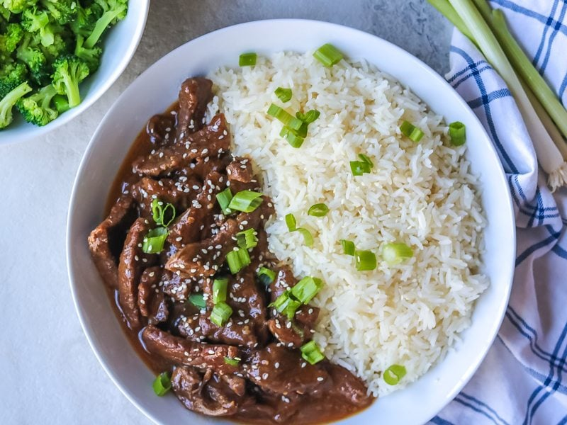 Pressure Cooker Mongolian beef in white bowl.