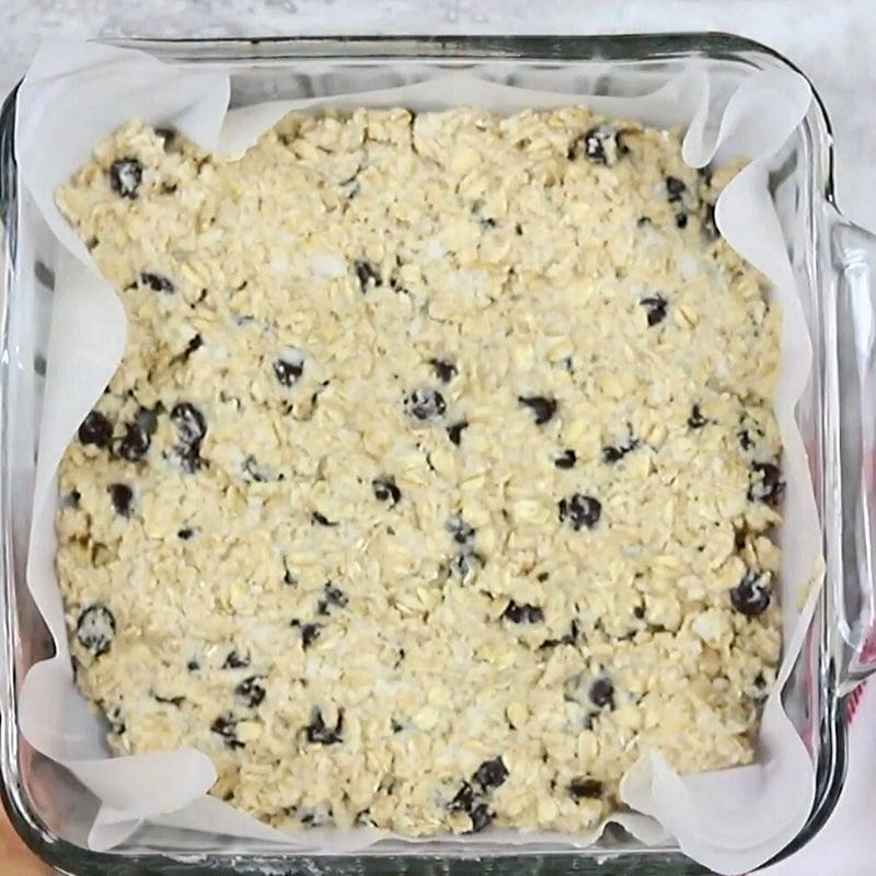 Chocolate Chip Oatmeal Bar Batter pressed in glass pan