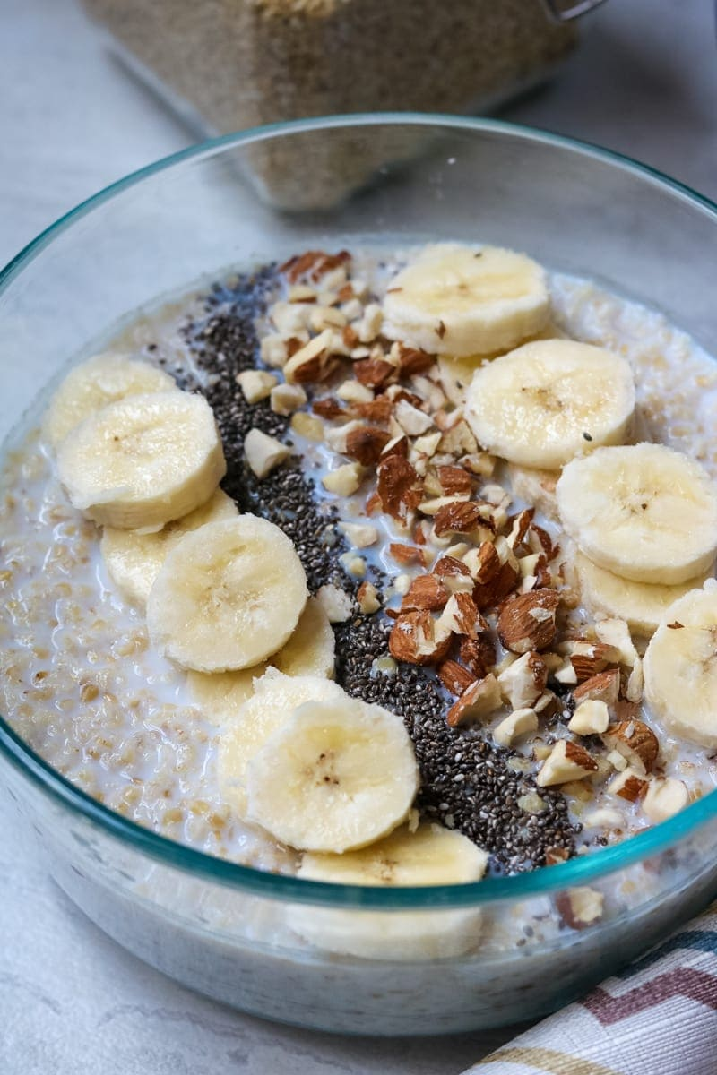 Steel Cut Oatmeal topped with chia seeds, bananas, and nuts
