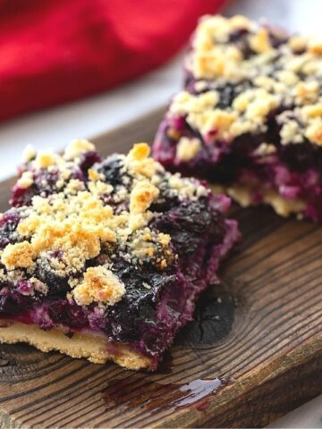 Blueberry Pie bars on wooden cutting board