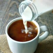 Homemade Coffee Creamer being poured into a white coffee mug