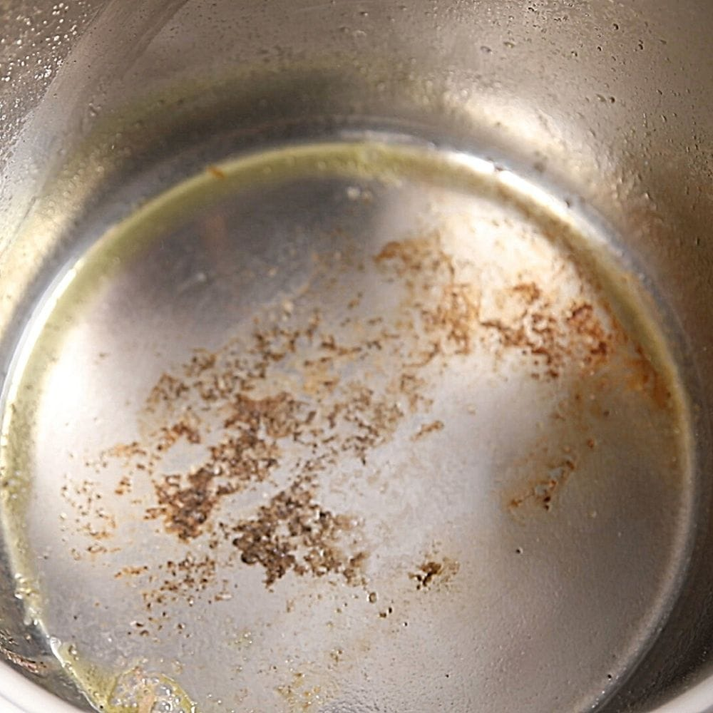 Burned food on bottom of inner pot