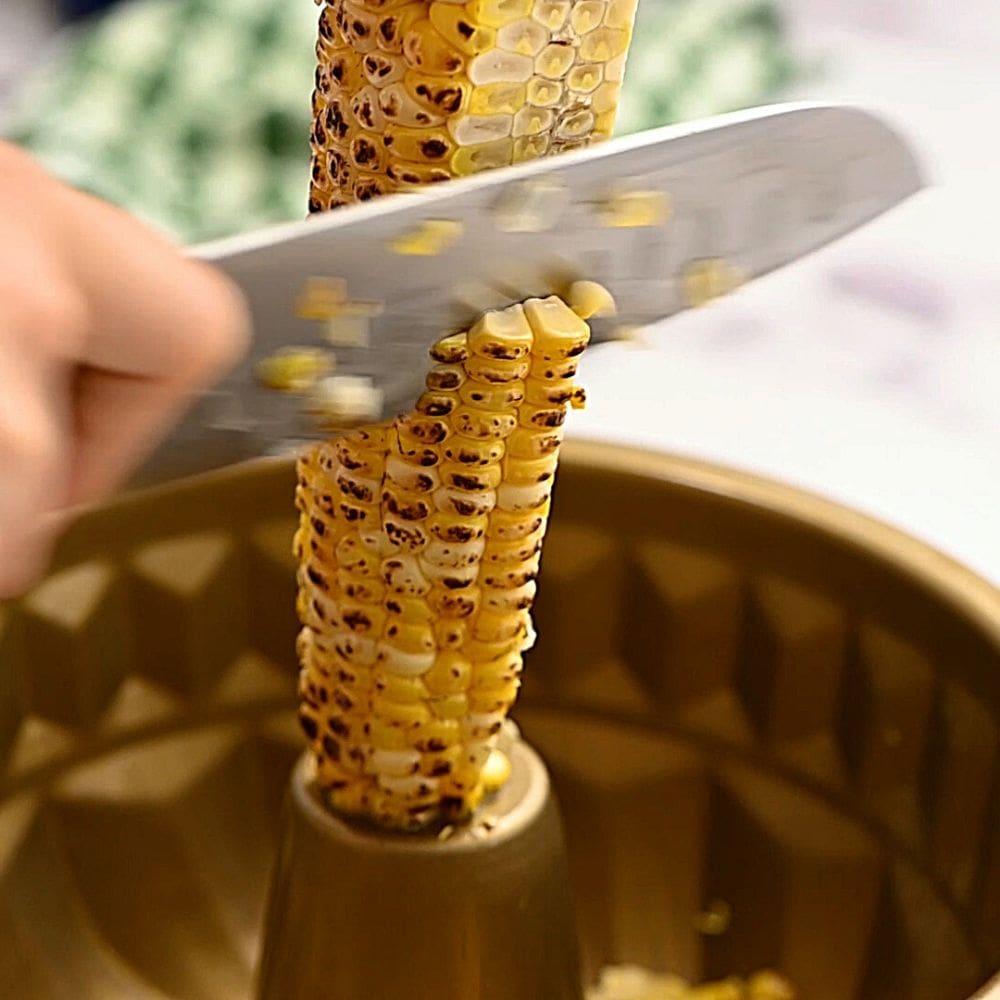 Corn taking off cob over bundt pan