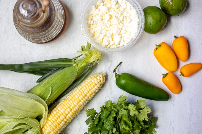 Ingredients for Corn Salsa: Corn on the cob, honey, feta, peppers, limes, cilantro