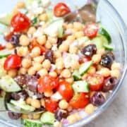 Close up of Chickpea Salad in glass serving bowl