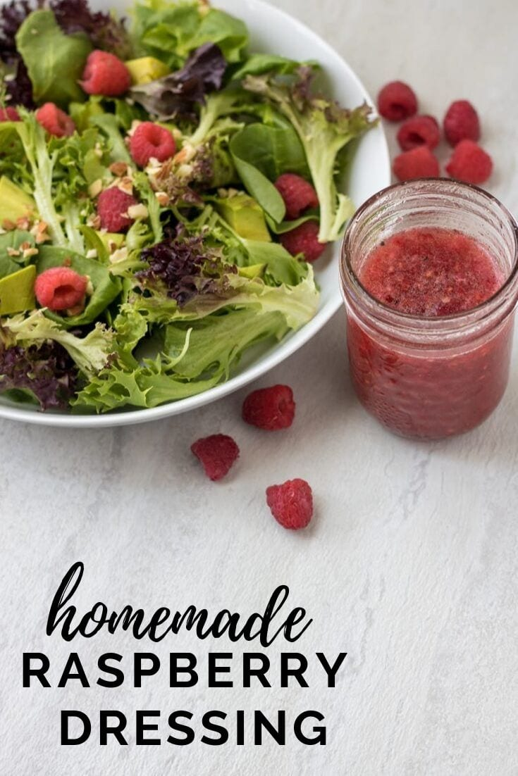 Dress up your salad with an easy Homemade Raspberry Dressing! This simple salad dressing made with fresh raspberries is sweet and tangy and makes simple salads POP with flavor!