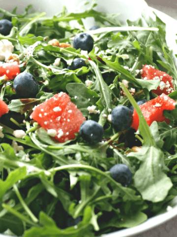 Blueberry, Watermelon, Feta and Arugula Salad in white bowl