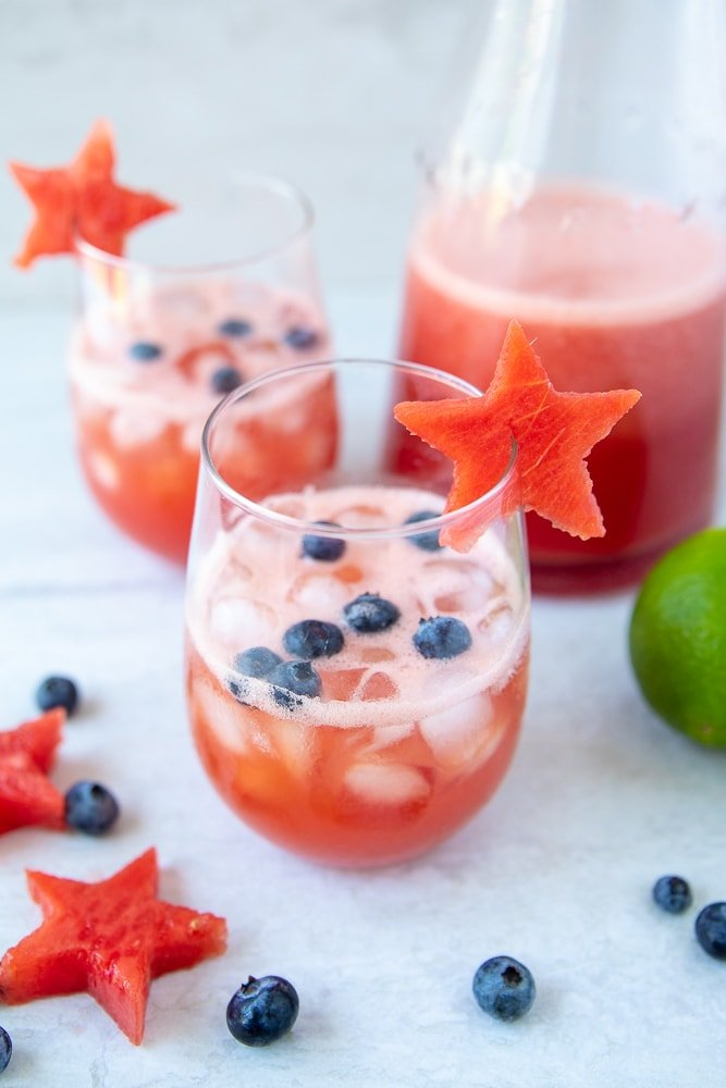 Watermelon Sangria in clear wine glass with blueberries and a watermelon star
