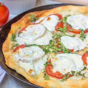 Fresh Tomato Pizza on baking sheet