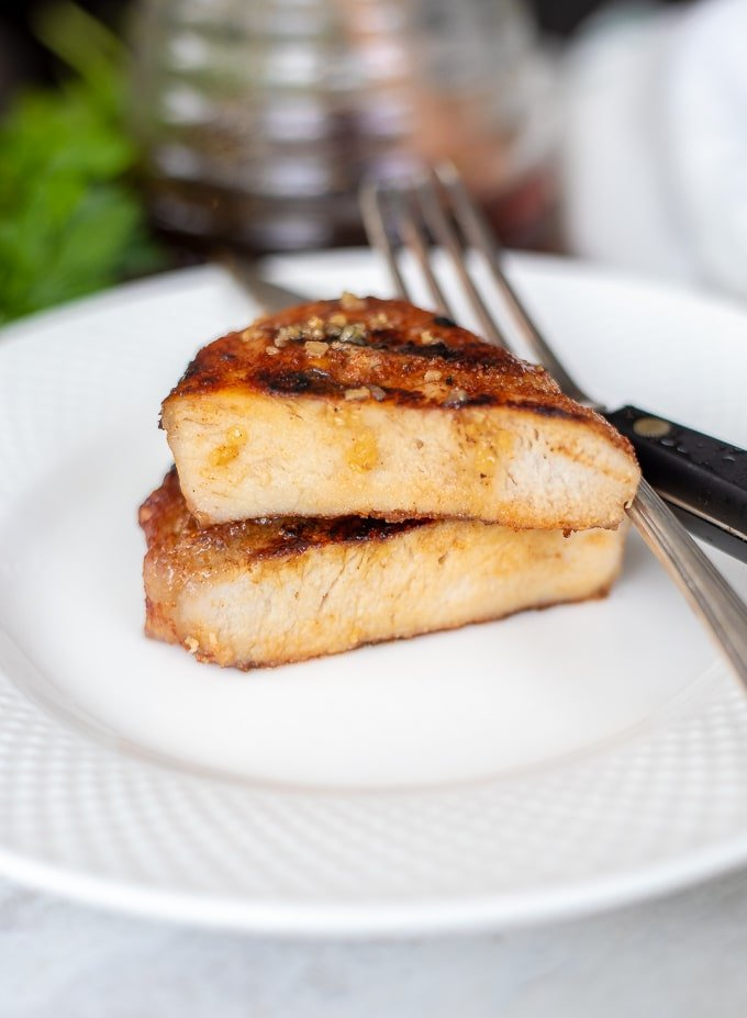 Honey Garlic Pork Chop Cut open on white plate