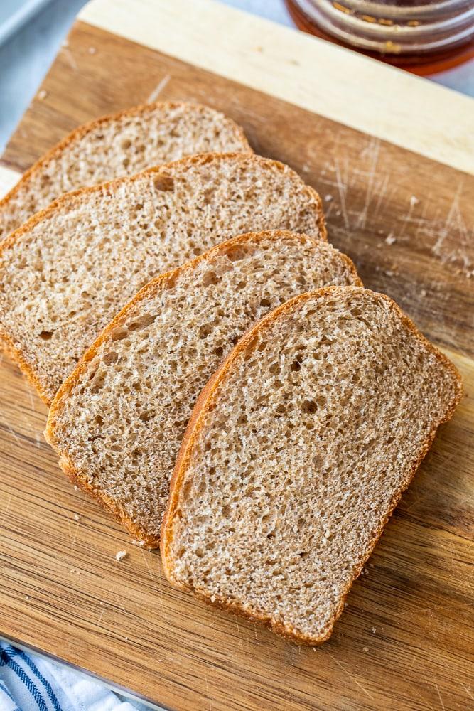 Sliced Wheat Bread on cutting board