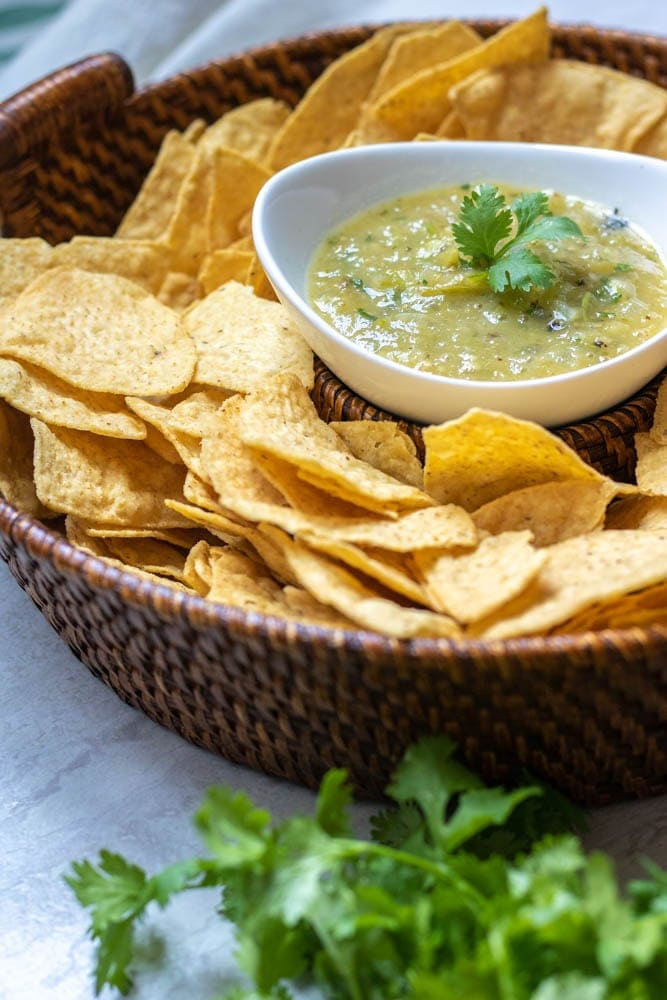 Bowl of Salsa Verde served with tortilla chips