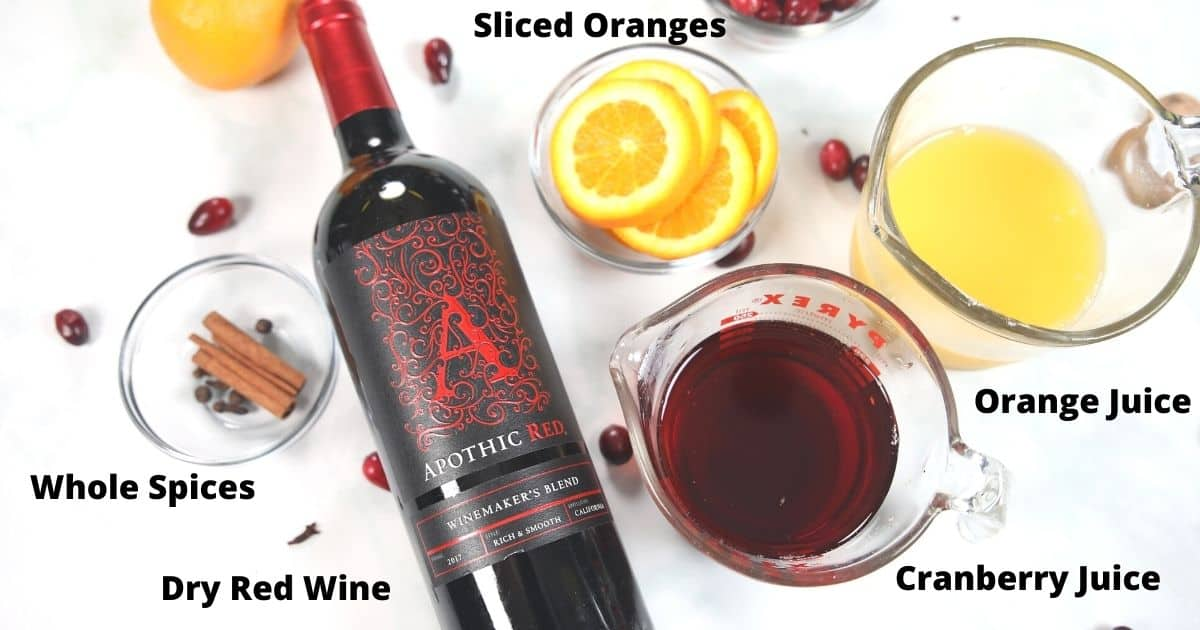 Ingredients for mulled wine labeled on white counter