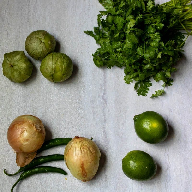 Cilantro, Tomatillos, limes, onions, and peppers