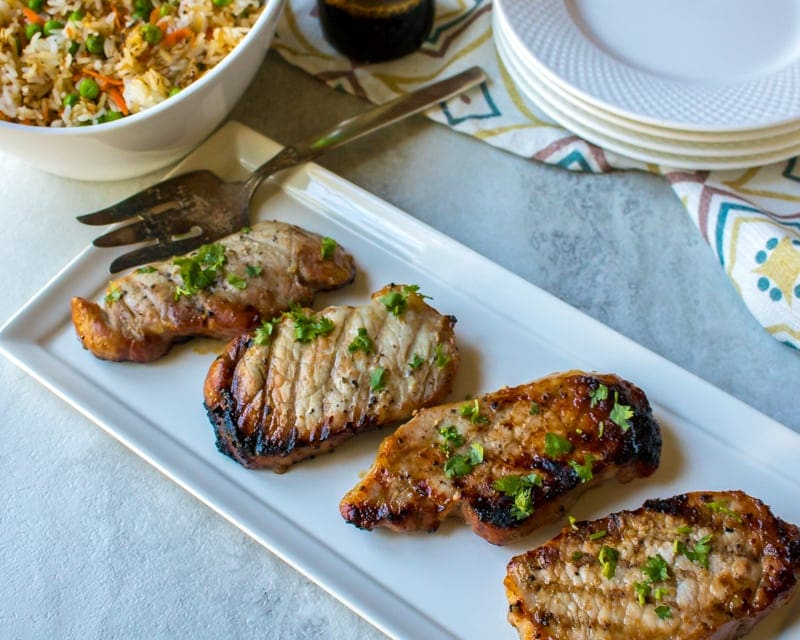 Grilled Pork Chops on white platter