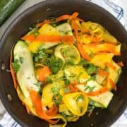 Saute pan with zucchini, yellow squash and carrot ribbons