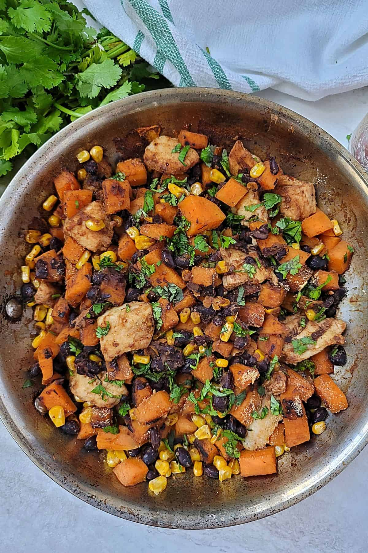 Skillet with chicken, sweet potatoes, and black beans.