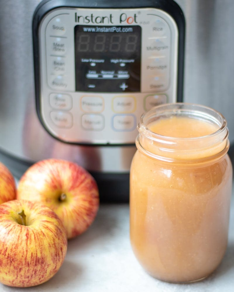 Jar of Homemade Applesauce Next to Instant Pot