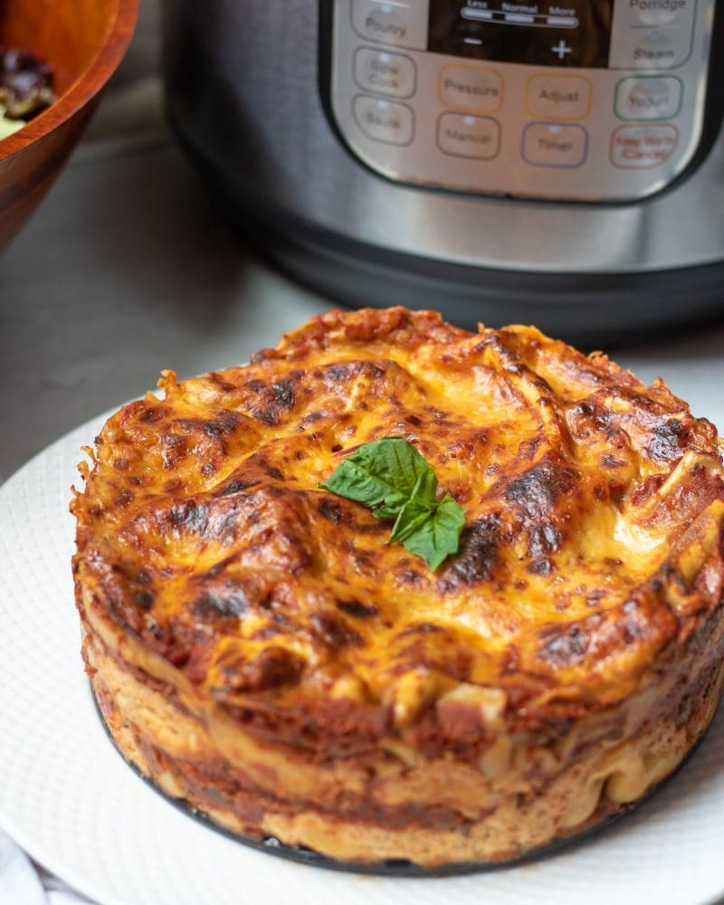 Lasagna sitting next to Instant Pot