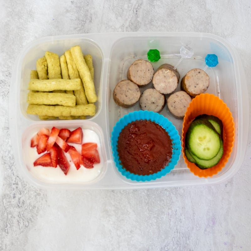 Italian Sausage with marinara sauce, yogurt and vegetables in lunchbox container