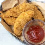Basket of homemade chicken strips with ketchup