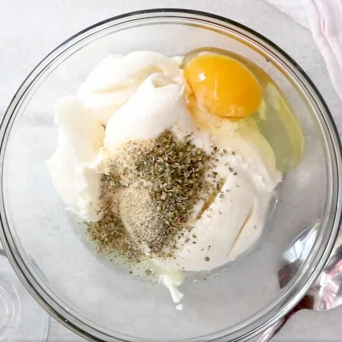 Ricotta mixture in mixing bowl for lasagan.
