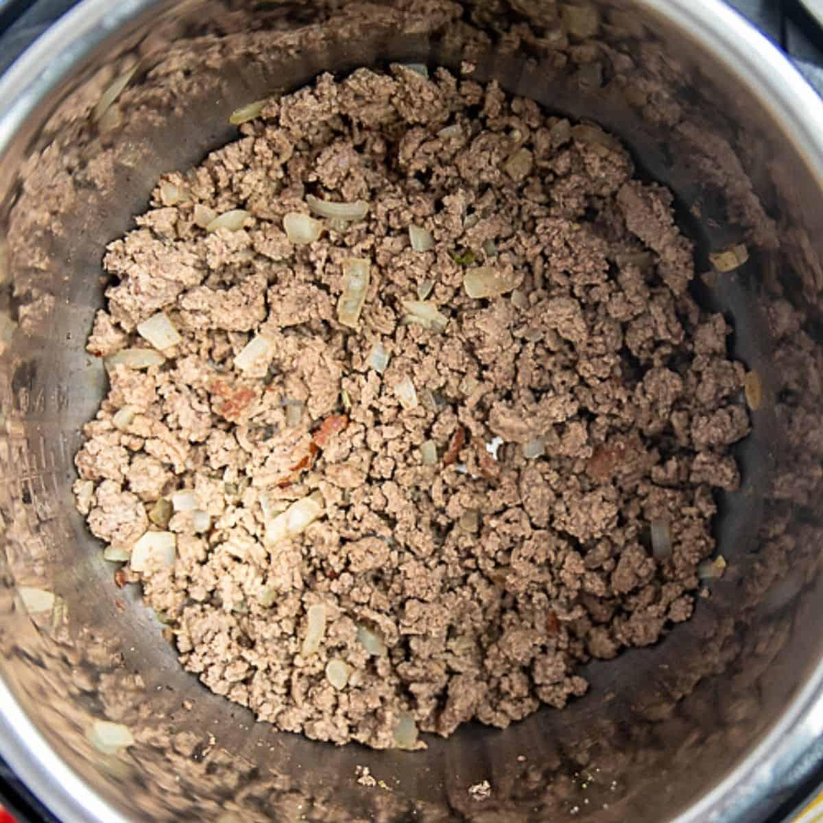 sauteed beef in inner pot of instant pot for lasagna.