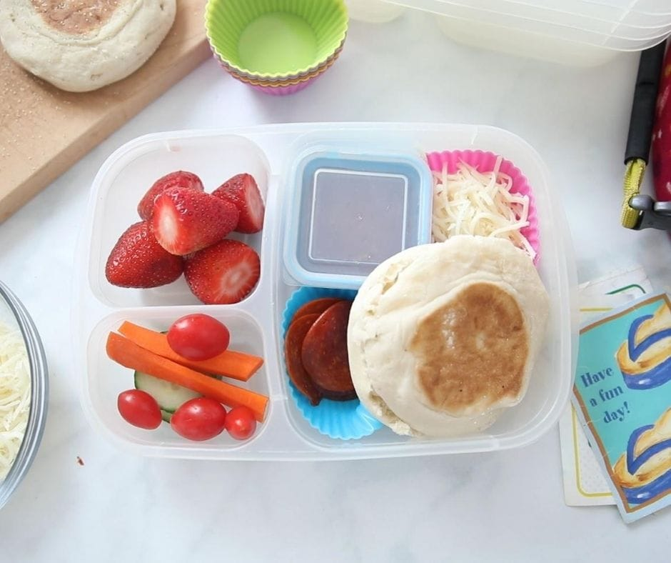 Lunch Container with English Muffin, shredded cheese, and pizza sauce with fruit and veggies