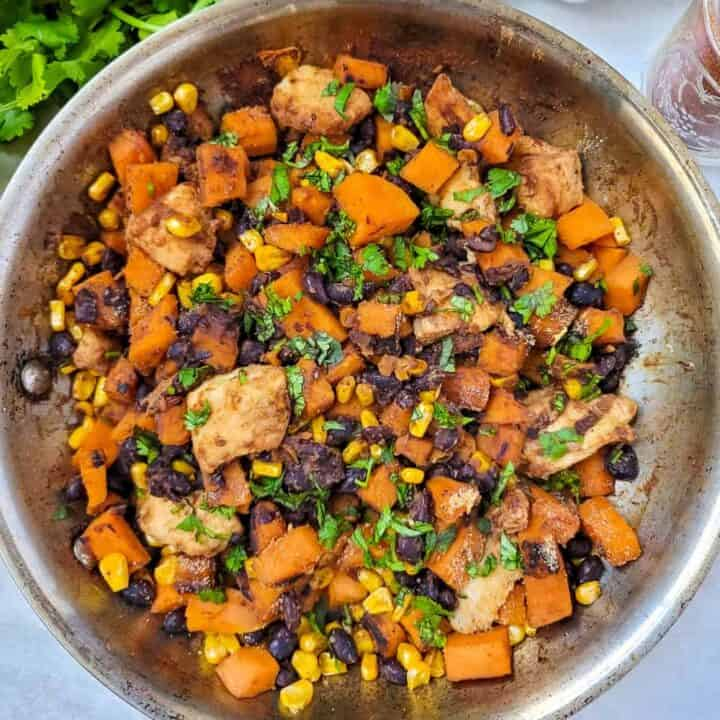 Skillet with Sweet Potatoes, Black Beans, and Chicken.