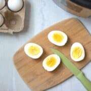 Perfect Hard Boiled Eggs Sliced Open on cutting board