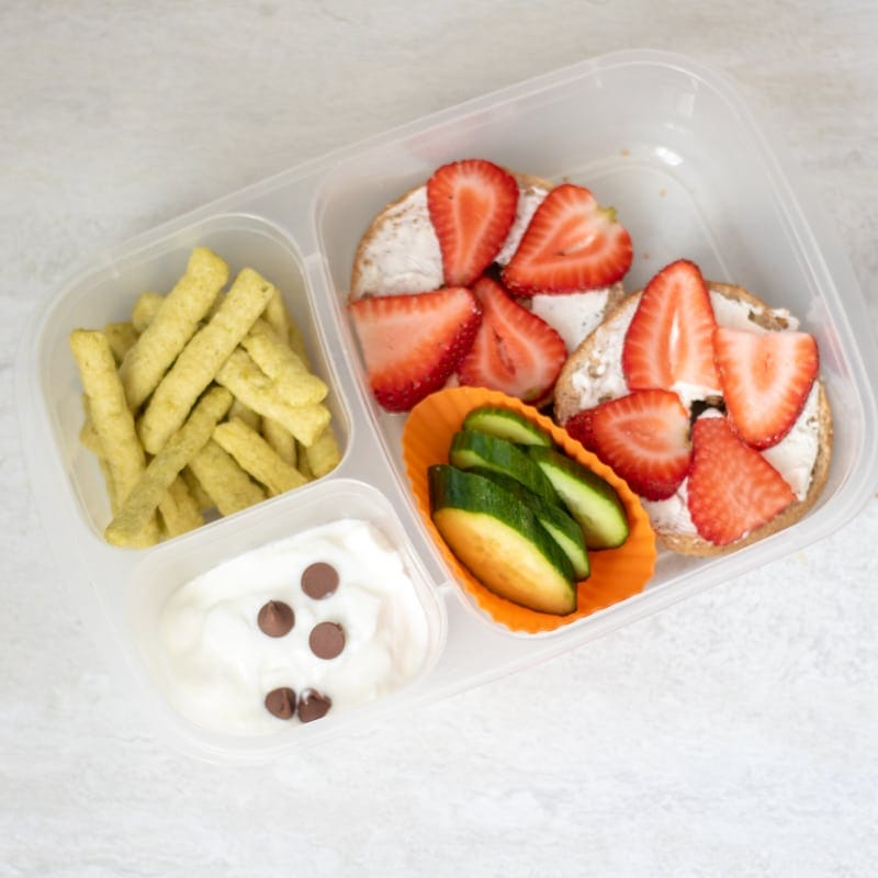 Strawberry Bagel with veggies and yogurt in bento lunch container