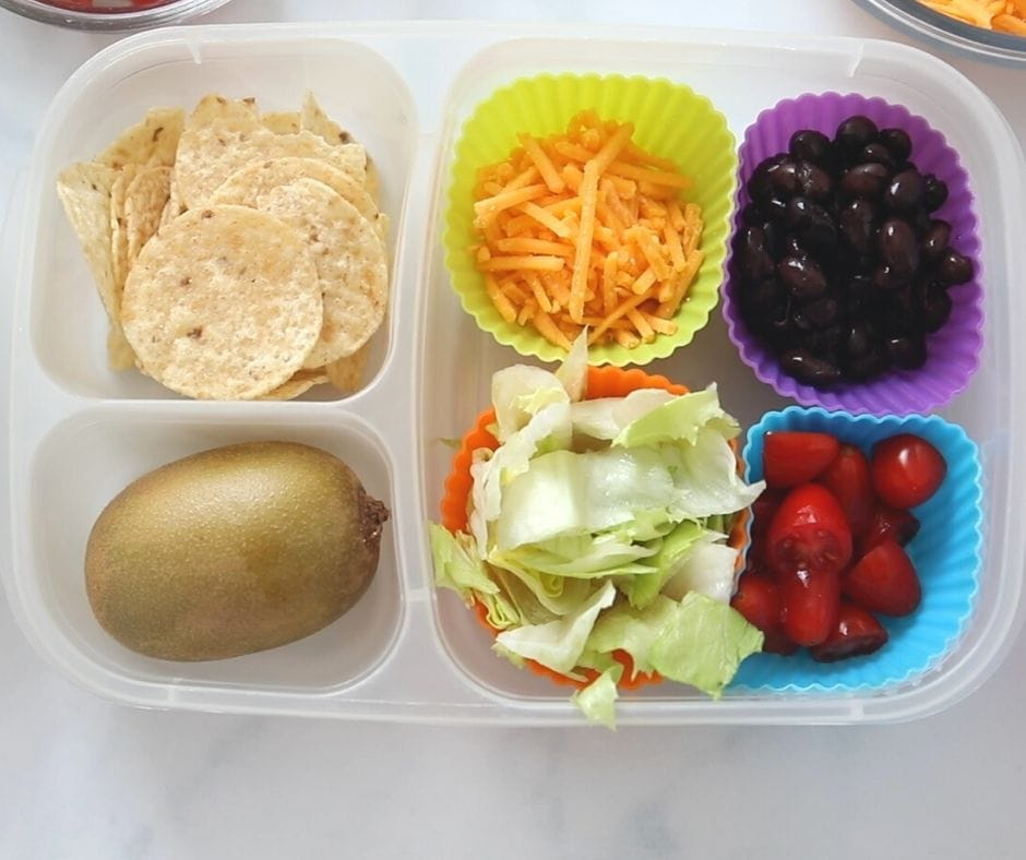 Ingredients for taco salad in lunch container