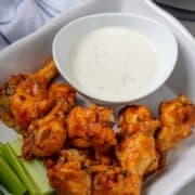 Platter of Instant Pot Wings next to ranch dressing