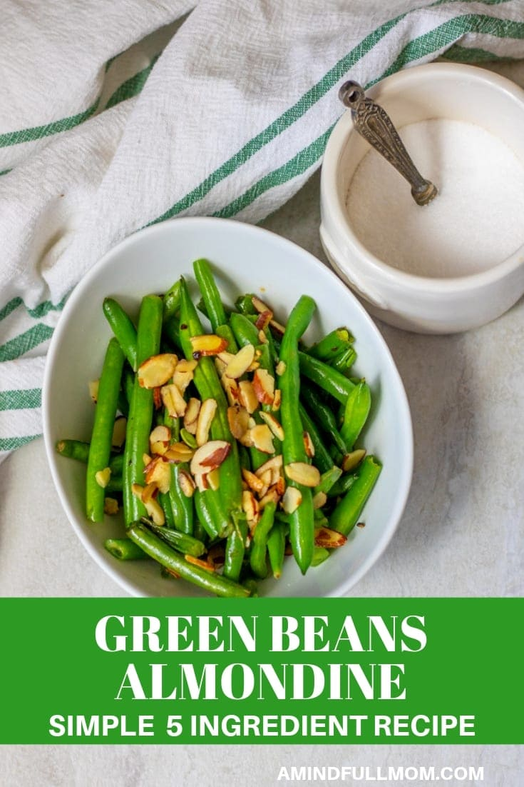 Classic French Green Beans Almondine is a simple, yet impressive and flavorful way to serve fresh green beans in a lemon butter sauce.#sidedish #lowcarb #keto #vegetarian #Thanksgiving #greenbeans