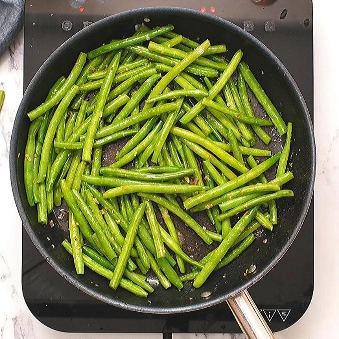 Green Beans in skillet with lemon butter sauce