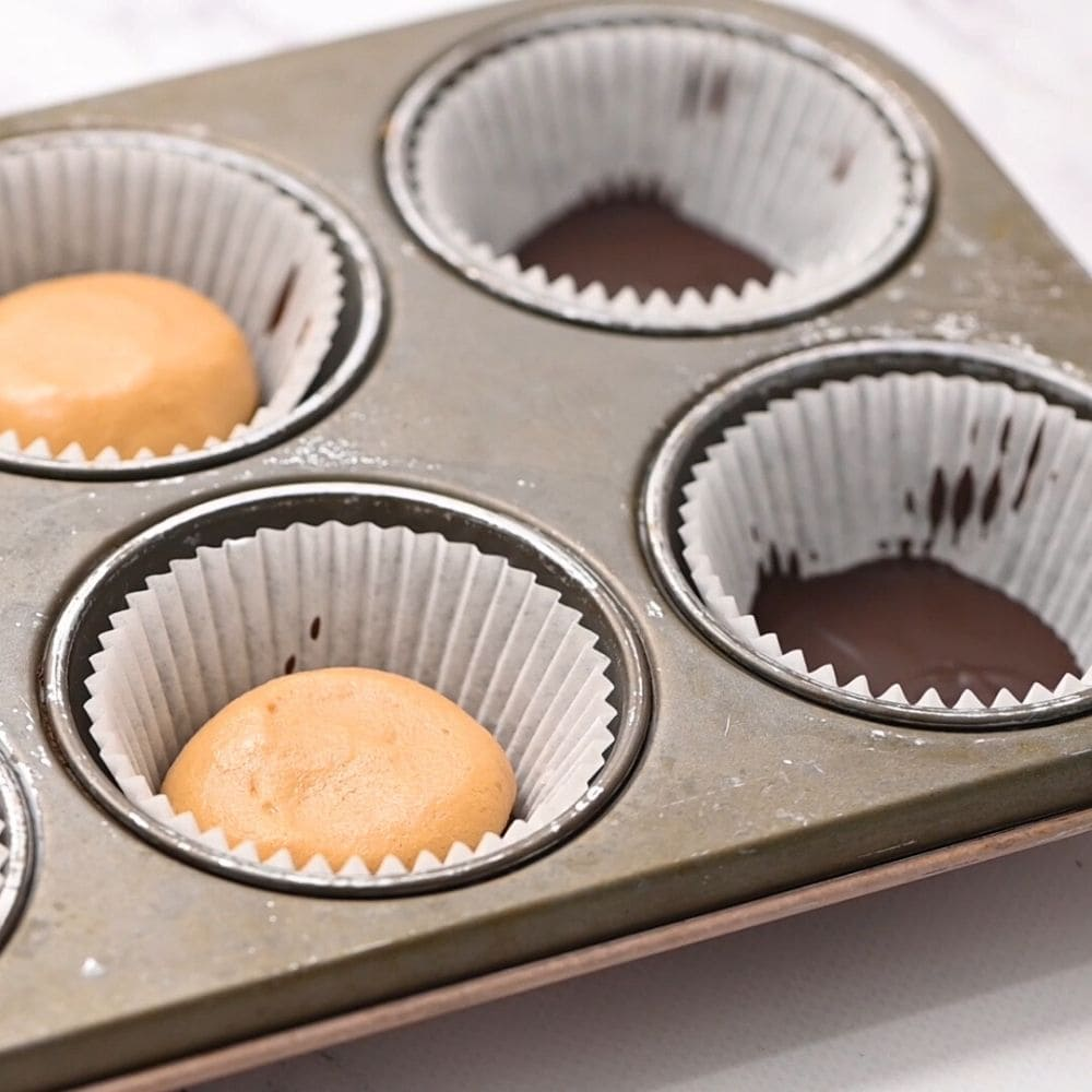 Peanut Butter layer on chocolate in muffin tin