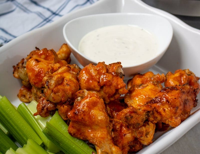 Buffalo Chicken Wings on White Platter served with ranch dressing