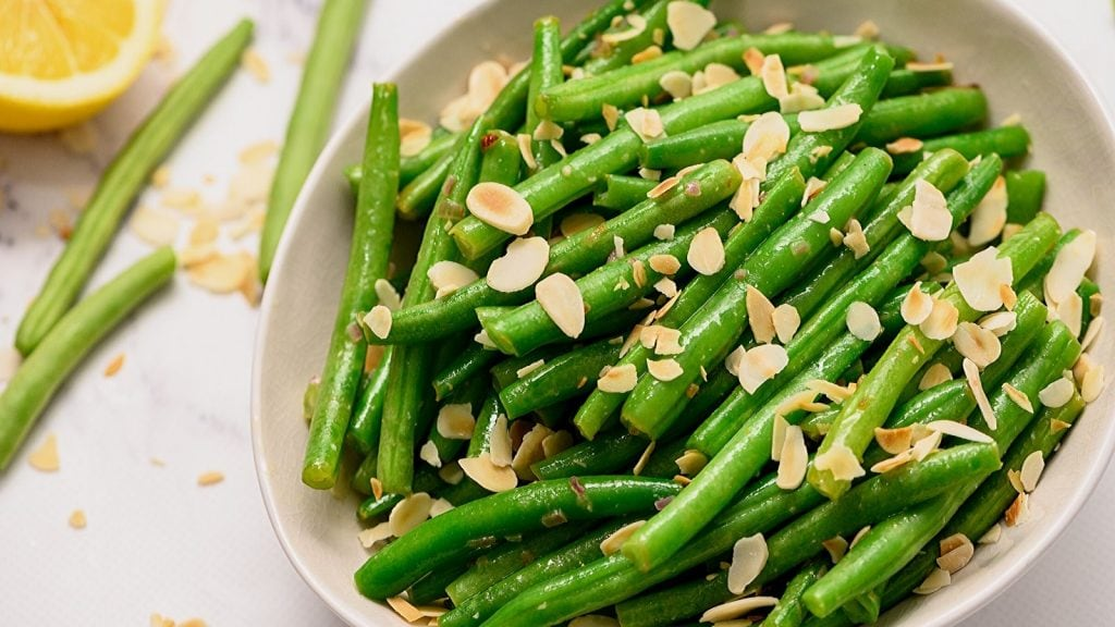 Green Beans Almondine in white serving platter