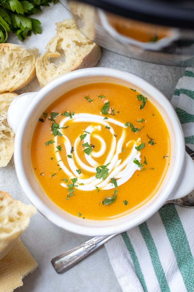 Bowl of Instant Pot Butternut Squash Soup topped with yogurt